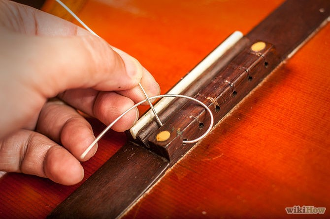 Thay dây đàn Guitar Classic